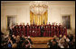 President George W. Bush stands on stage in the East Room of the White House with the Choir of Saint Patrick's Cathedral during a celebration of National Prayer Day Thursday, May 1, 2008. White House photo by Joyce N. Boghosian