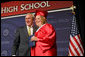President George W. Bush shares a smile with Megan Booth after presenting her with her diploma during commencement ceremonies for the Greensburg High School Class of 2008. The town of Greensburg, KS was almost entirely destroyed when a tornado tore through the town one year ago today. White House photo by Chris Greenberg