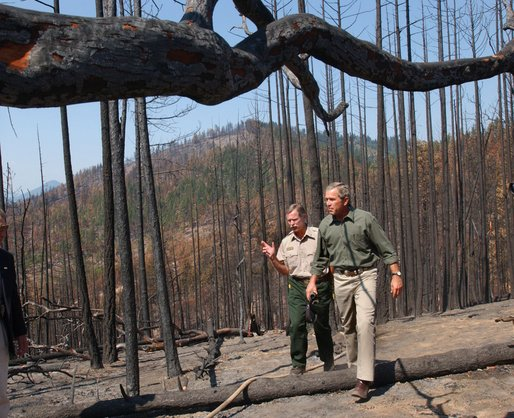 President George W. Bush tours the Squires Peak Fire Area in Medford, Ore., with Ron Wenker of the Medford Bureau of Land Management Properties District, Thursday, Aug. 22, 2002. White House photo by Eric Draper.