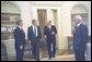President George W. Bush talks with Federal Reserve Board Chairman Alan Greenspan, Treasury Secretary Paul O'Neill and White House Chief of Staff Andy Card after their lunch meeting Thursday, August 1, 2002. White House photo by Eric Draper.