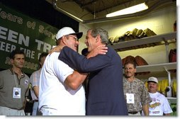 "President George W. Bush embraces rescued coal miner John Unger at the Green Tree Fire Department in Green Tree, Pa., Monday, Aug. 5. Pulled from a collapsed mine in Somerset, Pa., nine miners survived three days in a flooded mine shaft before rescuers found them. Also pictured are, from left to right, miners Mark Popernack, Randy Fogle and Tom Foy. ""Today we're here to celebrate life, the value of life, and as importantly, the spirit of America,"" said the President in his remarks. ""I asked to come by to meet our nine citizens and their families because I believe that what took place here in Pennsylvania really represents the best of our country, what I call the spirit of America, the great strength of our nation."" White House photo by Paul Morse."