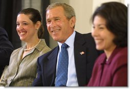President George W. Bush listens to a suggestion with panelists Carmen Agiuar, left, and Delia Garcia at the Corporate Responsibility discussion panel at the President's Economic Forum held at Baylor University in Waco, Texas on Tuesday August 13, 2002. White House photo by Paul Morse.