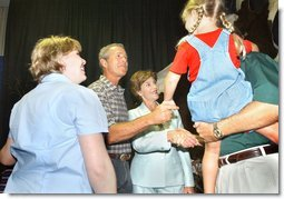 President George W. Bush and Mrs. Bush greet Crawford volunteers and their families during a luncheon to thank volunteers who have helped with events in the Crawford area, Friday, Aug. 16, 2002 in Crawford, Texas. White House photo by Eric Draper.
