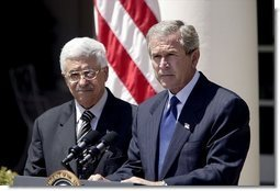 "President George W. Bush and Palestinian Prime Minister Mahmoud Abbas hold a joint press conference in the Rose Garden Friday, July 25, 2003. ""To break through old hatreds and barriers to peace, the Middle East needs leaders of vision and courage and a determination to serve the interest of their people. Mr. Abbas is the first Palestinian Prime Minister, and he is proving to be such a leader,"" said President Bush.  White House photo by Paul Morse"