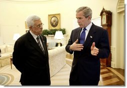 President George W. Bush and Palestinian Prime Minister Mahmoud Abbas meet in the Oval Office Friday, July 25, 2003. Meeting for the first time at the White House, the two leaders also held a working lunch and a joint press conference in the Rose Garden.  White House photo by Eric Draper