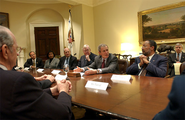 President George W. Bush meets with the President's Commission to Strengthen Social Security in the Roosevelt Room Jan. 18, 2002. Seated with the President are, from left to right, William Frenzel (far left), Mario Rodriguez, Gwendolyn King, Dr. John Cogan, Commission Co-chair Sen. Daniel Patrick Moynihan, Co-chair Richard D. Parsons and Deputy Chief of Staff Josh Bolten. White House photo by Eric Draper.