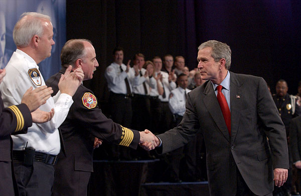 President George W. Bush greets local law enforcement officers after remarks on Citizen Preparedness at Lawrence Joel Veterans Memorial Coliseum in Winston-Salem, N.C. Wednesday, Jan 30, 2002. White House Photo by Eric Draper.