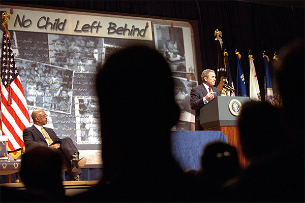 """""""The No Child Left Behind Act provides new training opportunities for teachers to develop their professional skills and their knowledge,"""" said President George W. Bush during an education rally at the Daughters of the American Revolution (DAR) Constitution Hall in Washington, D.C., Jan. 9. On stage with President Bush is Secretary of Education Rod Paige (far left) and Congressmen Rep. George Miller, U.S. Sen. Edward Kennedy and Rep. John Boehner (none are pictured). White House photo by Tina Hager."""