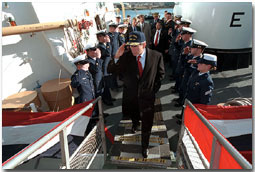 "President Bush salutes as he disembarks the ship after his tour Jan. 25. ""When it comes to securing our homeland, and helping people along the coast, the Coast Guard has got a vital and significant mission,"" said the President in his remarks at nearby Southern Maine Technical College. ""And, therefore, the budget that I send to the United States Congress will have the largest increase in spending for the Coast Guard in our nation's history."" White House photo by Eric Draper."