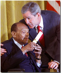 President George W. Bush honors music legend Lionel Hampton during a ceremony recognizing Black Music Month in the East Room of the White House on June 30, 2001. WHITE HOUSE PHOTO BY PAUL MORSE