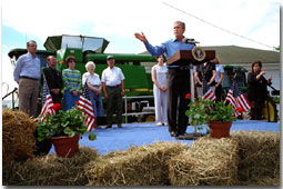 President Bush returned to Tom and Judy Barrett's farm in Dallas City, Iowa, to celebrate the tax cut Friday, June 8.