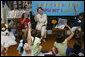 Laura Bush discusses the importance of reading with children participating in the No Child Left Behind Summer Reading Program at the Portsmouth Public Library in Portsmouth, New Hampshire, Friday, July 9, 2004. White House photo by Joyce Naltchayan