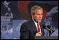 """During a tour of equpiment from Libya's former nuclear weapons program, President George W. Bush delivers remarks on the War on Terror at the Oak Ridge National Laboratory in Oak Ridge, Tenn., Monday, July 12, 2004. """"These materials are the sobering evidence of a great danger. Certain regimes, often with ties to terrorist groups, seek the ultimate weapons as a shortcut to influence,"""" said the President. """"These materials, voluntarily turned over by the Libyan government, are also encouraging evidence that nations can abandon those ambitions and choose a better way."""" White House photo by Tina Hager"""