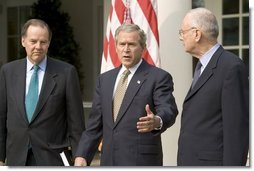 Accompanied by Chairman Thomas Kean, left, and Vice Chairman Lee Hamilton of the 911 Commission, President George W. Bush addresses the press during the presentation of the Commission's report in the Rose Garden Thursday, July 22, 2004.   White House photo by Eric Draper