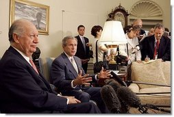"""President George W. Bush and President Ricardo Lagos of Chile meet in the Oval Office Monday, July 19, 2004. """"One of the things that has worked well is the free trade agreement with Chile, and we talked about that today,"""" said President Bush.  White House photo by Paul Morse"""