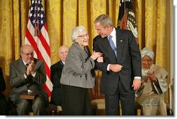 "President George W. Bush awards the Presidential Medal of Freedom to author Harper Lee during a ceremony Monday, Nov. 5, 2007, in the East Room. ""To Kill a Mockingbird has influenced the character of our country for the better. It's been a gift to the entire world. As a model of good writing and humane sensibility, this book will be read and studied forever,"" said the President about Harper Lee's work. White House photo by Eric Draper"