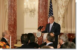 President George W. Bush addresses his remarks at the Secretary of State's Dinner Monday evening, Nov. 26, 2007 at the State Department in Washington, D.C., welcoming the participants attending the Annapolis Conference. White House photo by Chris Greenberg