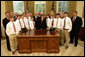 President George W. Bush stands with members of the Warner Robins, Georgia Little League team, champions of the 2007 Little League World Series, Thursday, Nov. 1, 2007, in the Oval Office of the White House. The Southeast Champs defeated the Tokyo Kitasuna Little Leaguers 3-2 in the championship game in August in Williamsport, Pa. White House photo by Eric Draper