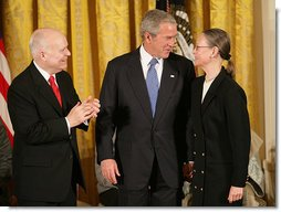 """President George W. Bush congratulates C-SPAN founder Brian Lamb and his wife Victoria during the presentation of the Presidential Medal of Freedom Monday, Nov. 5, 2007, in the East Room. """"For nearly 30 years, the proceedings of the House of Representatives have been televised -- unfiltered, uninterrupted, unedited, and live,"""" said the President. """"For this we can thank the Cable-Satellite Public Affairs Network, or C-SPAN. And for C-SPAN, we can thank a visionary American named Brian Lamb."""" White House photo by Eric Draper"""