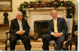 """President George W. Bush and President Mahmoud Abbas of the Palestinian Authority meet in the Oval Office of the White House Monday, Nov. 26, 2007. In welcoming his fellow leader to the White House, President Bush said, """"Thank you for coming, and thank you for working hard to implement a vision for a Palestinian state. We want the people in the Palestinian Territories to have hope. And we thank you for your willingness to sit down with Israel to negotiate the settlement.""""  White House photo by Eric Draper"""