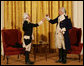 General George Washington (played by Dean Malissa) and General Marie Joseph Paul Yves Roch Gilbert du Motier, the Marquis de LaFayette (played by Benjamin Goldman), toast each other at the beginning of their dialogue Tuesday, Nov. 6, 2007, during the entertainment in the East Room following a dinner in honor of President Nicolas Sarkozy at the White House. White House photo by Chris Greenberg
