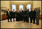 Presidents George W. Bush stands with the recipients of the 2006 Presidential Awards for Excellence in Science, Mathematics, and Engineering Mentoring Friday, Nov. 16, 2007, in the Oval Office. White House photo by Joyce N. Boghosian