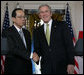 President George W. Bush and Prime Minister Yasuo Fukuda of Japan exchange handshakes following their joint statement Friday, Nov. 16, 2007, at the White House. White House photo by Chris Greenberg