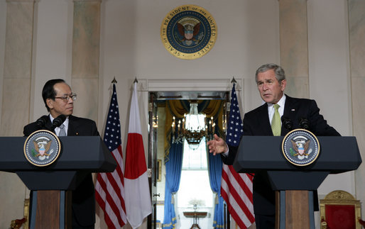 """As Prime Minister Yasuo Fukuda of Japan looks on, President George W. Bush makes remarks during a joint statement Friday, Nov. 16, 2007, in the Cross Hall of the White House. Said the President, """"The alliance between our two countries is rooted deeply in our strong commitments to freedom and democracy."""" White House photo by Chris Greenberg"""