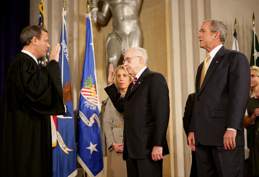 "President George W. Bush attends the swearing in of Attorney General Michael Mukasey Wednesday, Nov. 14, 2007, at the U.S. Department of Justice in Washington, D.C. Chief Justice of the United States John Roberts conducted the ceremony.""The Attorney General must run the world's largest law firm, and the central agency for enforcement of our federal laws,"" said President Bush. ""He must aggressively prosecute gun criminals and drug dealers, hold corporate wrongdoers to account, protect victims of child abuse and domestic violence, and uphold the civil rights of every American."" White House photo by Eric Draper"