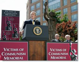 "President George W. Bush addresses his remarks Tuesday, June 12, 2007, at the dedication ceremony for the Victims of Communism Memorial in Washington, D.C. President Bush, in recalling the lessons of the Cold War said, ""that freedom is precious and cannot be taken for granted; that evil is real and must be confronted."" White House photo by Joyce N. Boghosian"