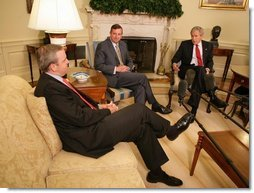 """President George W. Bush meets with White House Counselor Dan Bartlett, left, and Ed Gillespie in the Oval Office Wednesday, June 13, 2007. In announcing Mr. Gillespie as his new Counselor, President Bush said, """"When Dan told me that he was going to leave the White House so he could spend more time with his three young children and his wife, I never thought I'd be able to find somebody that could possibly do as good a job as he has done. I'm fortunate that Ed Gillespie has agreed to join the administration."""" White House photo by Eric Draper"""