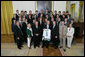 President George W. Bush stands with members of the Michigan State University Men's Ice Hockey 2007 Championship Team Monday, June 18, 2007 at the White House, during a photo opportunity with the 2006 and 2007 NCAA Sports Champions. White House photo by Eric Draper