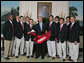 President George W. Bush stands with members of the Stanford University Men's Golf 2006 Championship Team Monday, June 18, 2007 at the White House, during a photo opportunity with the 2006 and 2007 NCAA Sports Champions. White House photo by Joyce N. Boghosian