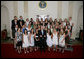 President George W. Bush stands with members of the Northwestern University Women's Lacrosse 2006 Championship Team Monday, June 18, 2007 at the White House, during a photo opportunity with the 2006 and 2007 NCAA Sports Champions. White House photo by Eric Draper