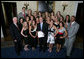 President George W. Bush stands with members of the University of Georgia Women's Gymnastics 2007 Championship Team Monday, June 18, 2007 at the White House, during a photo opportunity with the 2006 and 2007 NCAA Sports Champions. White House photo by Eric Draper