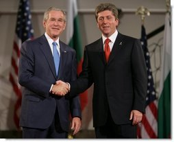 President George W. Bush and President Georgi Parvanov shake hands at the conclusion of their joint press availability Monday, June 11, 2007, in Sofia, Bulgaria.  White House photo by Chris Greenberg