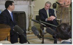 "President George W. Bush listens to remarks by President Nguyen Minh Triet of Vietnam during his visit Friday, June 22, 2007, to the Oval Office. "".I would like to take this opportunity to send a message to American people,"" said President Triet, during the meeting. "".If both peoples both want peace, friendship and solidarity, then we should join hands and march toward the future."" White House photo by Eric Draper"