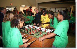 President George W. Bush joins a heated game of foosball Friday, June 15, 2007, during his visit to the Boys and Girls Club of South Central Kansas - 21st Street Club in Wichita. White House photo by Eric Draper