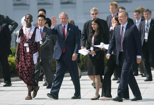 Joined by Prime Minister Tony Blair of the United Kingdom, President George W. Bush waves to the cameras as they walk with Junior G8 Student Leaders including the U.S. representative Kavitha Narra, following their meeting Thursday, June 7, 2007, in Heiligendamm, Germany. The 16-year-old is a junior at San Jose's Harker School and is one of eight students who made the trip to the J8. White House photo by Eric Draper