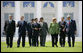 Leaders of the G8 walk across the grass en route to the official photograph Thursday, June 7, 2007, in Heiligendamm, Germany. From left are: Prime Minister Stephen Harper of Canada; Prime Minister Tony Blair of the United Kingdom; Jose Manuel Barroso, President of the European Commission; President Nicolas Sarkozy of France; President Vladimir Putin of Russia; Prime Minister Shinzo Abe of Japan; Chancellor Angela Merkel of Germany; Prime Minister Romano Prodi of Italy, and President George W. Bush. White House photo by Eric Draper