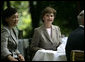 Mrs. Laura Bush sits with Mrs. Akie Abe during coffee Thursday, June 7, 2007, in the Castle Garden at Burg Schlitz in Hohen Demzin, Germany. White House photo by Shealah Craighead