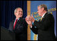 President George W. Bush is applauded by Rhode Island Governor Donald L. Carcieri prior to his address at the Naval War College in Newport, R.I., Thursday, June 28, 2007. White House photo by Eric Draper