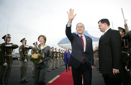 President George W. Bush waves as he and Mrs. Laura Bush arrive Monday, June 4, 2007, at Prague Ruzyne Airport in the Czech Republic where they will begin their seven-day Europe visit. White House photo by Eric Draper