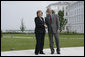 President George W. Bush stands with German Chancellor Angela Merkel as they meet for lunch Wednesday, June 6, 2007, at the Kempinski Grand Hotel in Heiligendamm, Germany. White House photo by Eric Draper