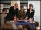 Mrs. Laura Bush participates in a ribbon-cutting Wednesday, June 6, 2007, at the Schwerin City Library in Schwerin, Germany. Joining her are Norbert Claussen, Lord Mayor of Schwerin, and Heidrun Hamann, the Director of the library. White House photo by Shealah Craighead
