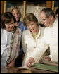 Mrs. Laura Bush and Mrs. Livia Klausova, First Lady of Czech Republic, look through a book during their visit to the Strahov Archives and Library Tuesday, June 5, 2007, in Prague, Czech Republic. More than 800 years old, it is home to a library, gallery of art and monastery. White House photo by Shealah Craighead