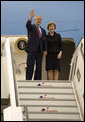 President George W. Bush and Mrs. Laura Bush wave as they arrive Tuesday, June 6, 2007, in Rostock, Germany. The couple will spend the next two days in nearby Heiligendamm, site of this year's G8 Summit. White House photo by Eric Draper
