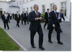 President George W. Bush and Prime Minister Tony Blair of the United Kingdom walk to the Grand Hotel after their meeting Thursday, June 7, 2007, in the Music Salon of the Kempinski Grand Hotel in Heiligendamm, Germany. Among the issues covered, the two leaders discussed AIDS, global warming and Darfur.  White House photo by Eric Draper