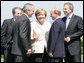 President George W. Bush shares a moment with President Vladimir Putin of Russia, and Chancellor Angela Merkel of Germany, after a photo opportunity with Outreach Representatives at the G8 Summit in Heiligendamm, Germany. With them are Prime Minister Romano Prodi, left, of Italy, and Prime Minister Tony Blair of the United Kingdom. White House photo by Eric Draper