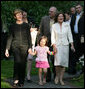 Mrs. Laura Bush walks with Maria Kaczynski, wife of Polish President Lech Kaczynski, and her granddaughter, Ewa, during a visit Friday, June 8, 2007, to the Polish presidential seaside retreat in Jurata, Poland. White House photo by Eric Draper